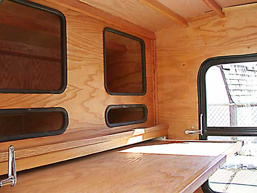 Interior View Of Teardrop Trailer With A Pull Out Desk Top